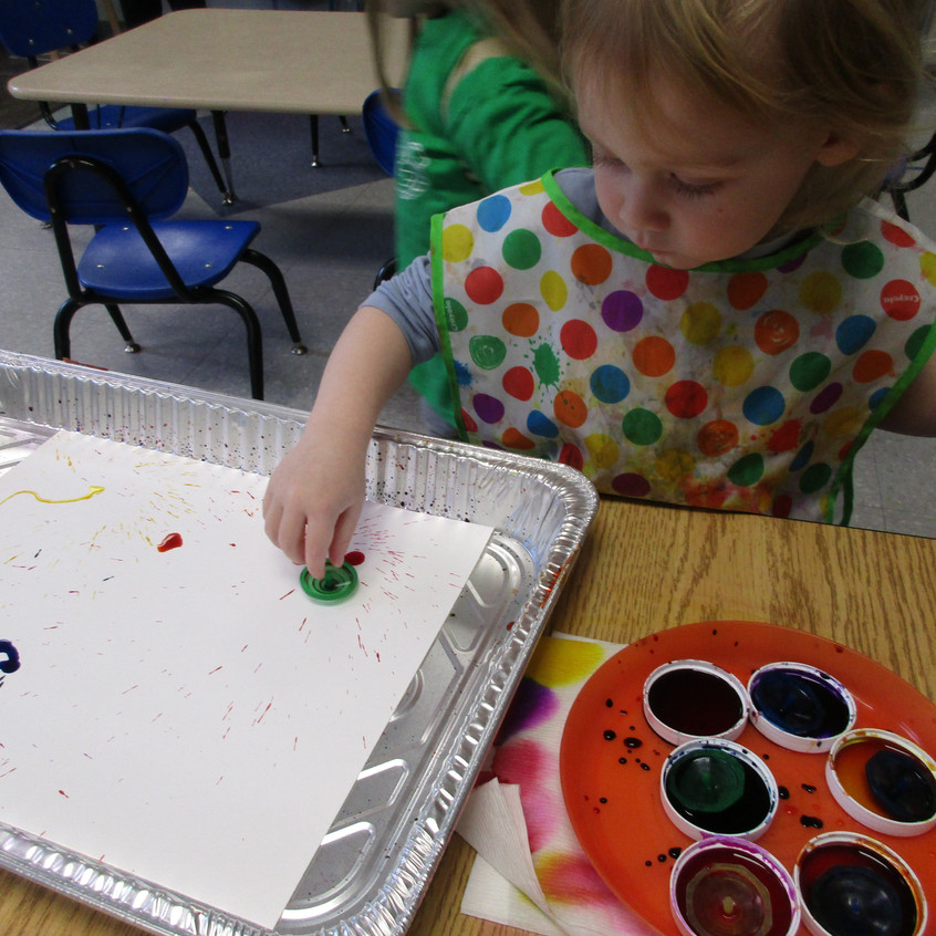 Spinning dreidels in paint
