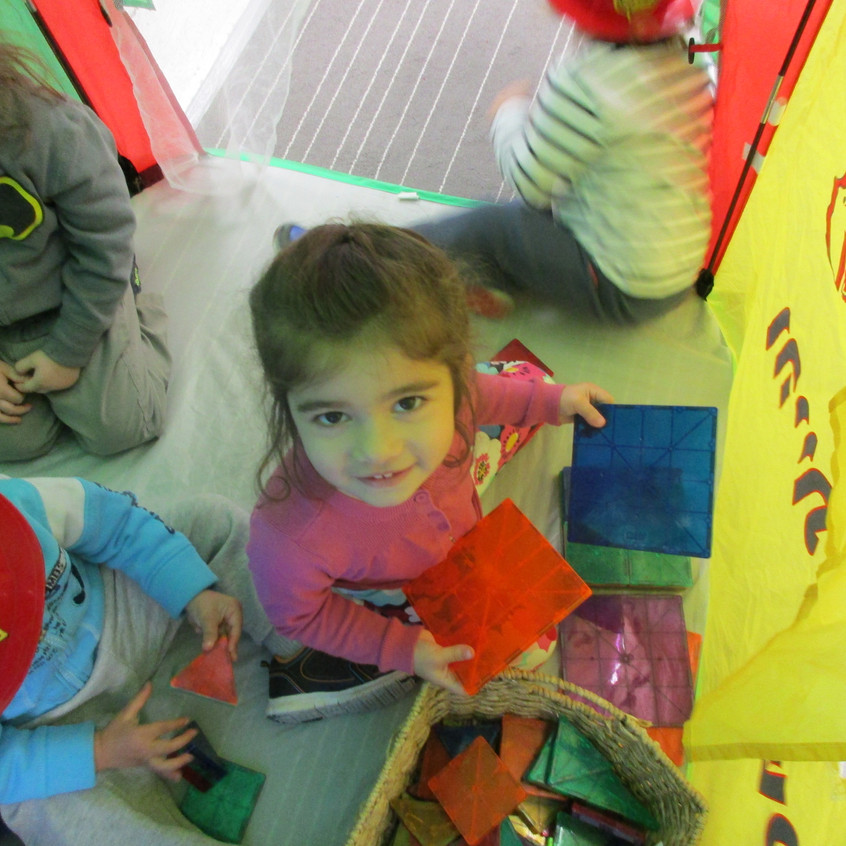 Playing in the sukkah