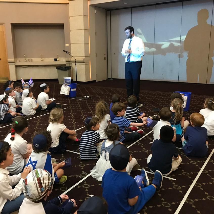 Rabbi Antine talking to the children