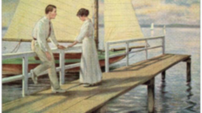 Couple sur l'embarcadère devant un voilier © F. Mitwoch