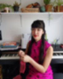 Anushka Knitting by the Piano.jpg