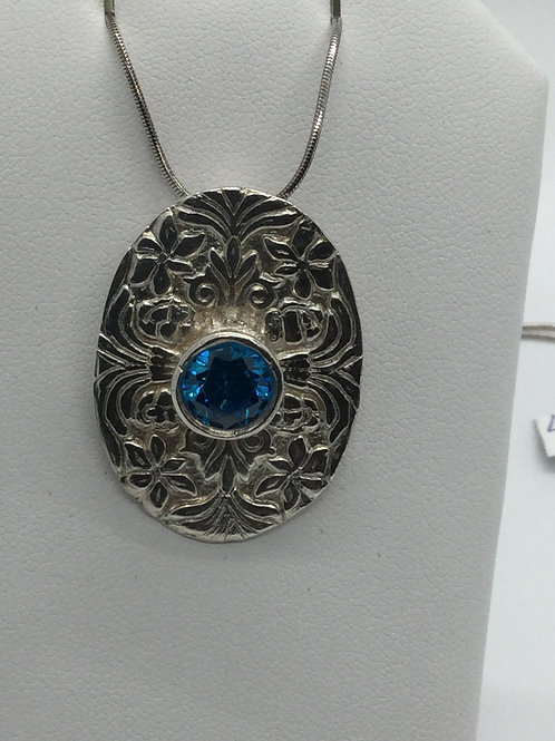 Southern Tapestry Pendant with round Blue Topaz CZ