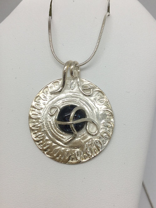 Medallion with navy cabochon glass