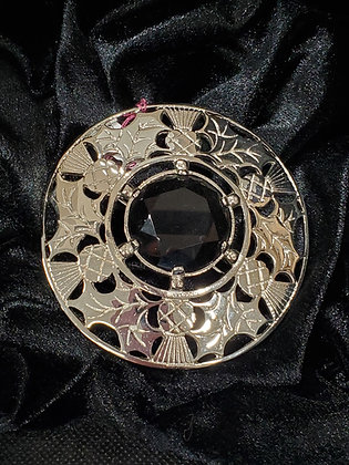 Carved Thisle Plaidie Broach in Sterling Silver with Dark Green Stone