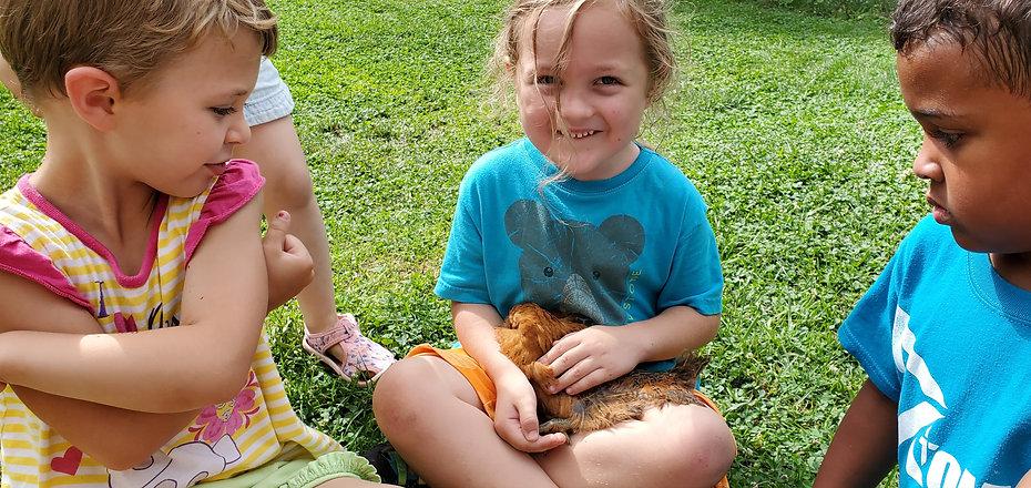 Rainier with chicken.jpg