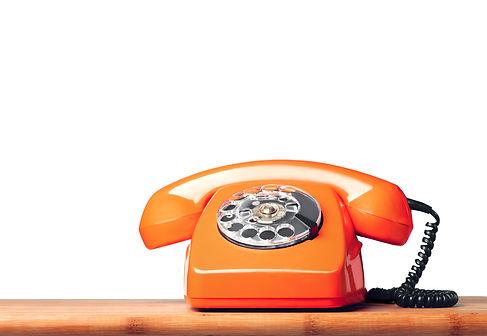 Vintage orange phone on the table Isolat