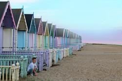 boy beach hut photo
