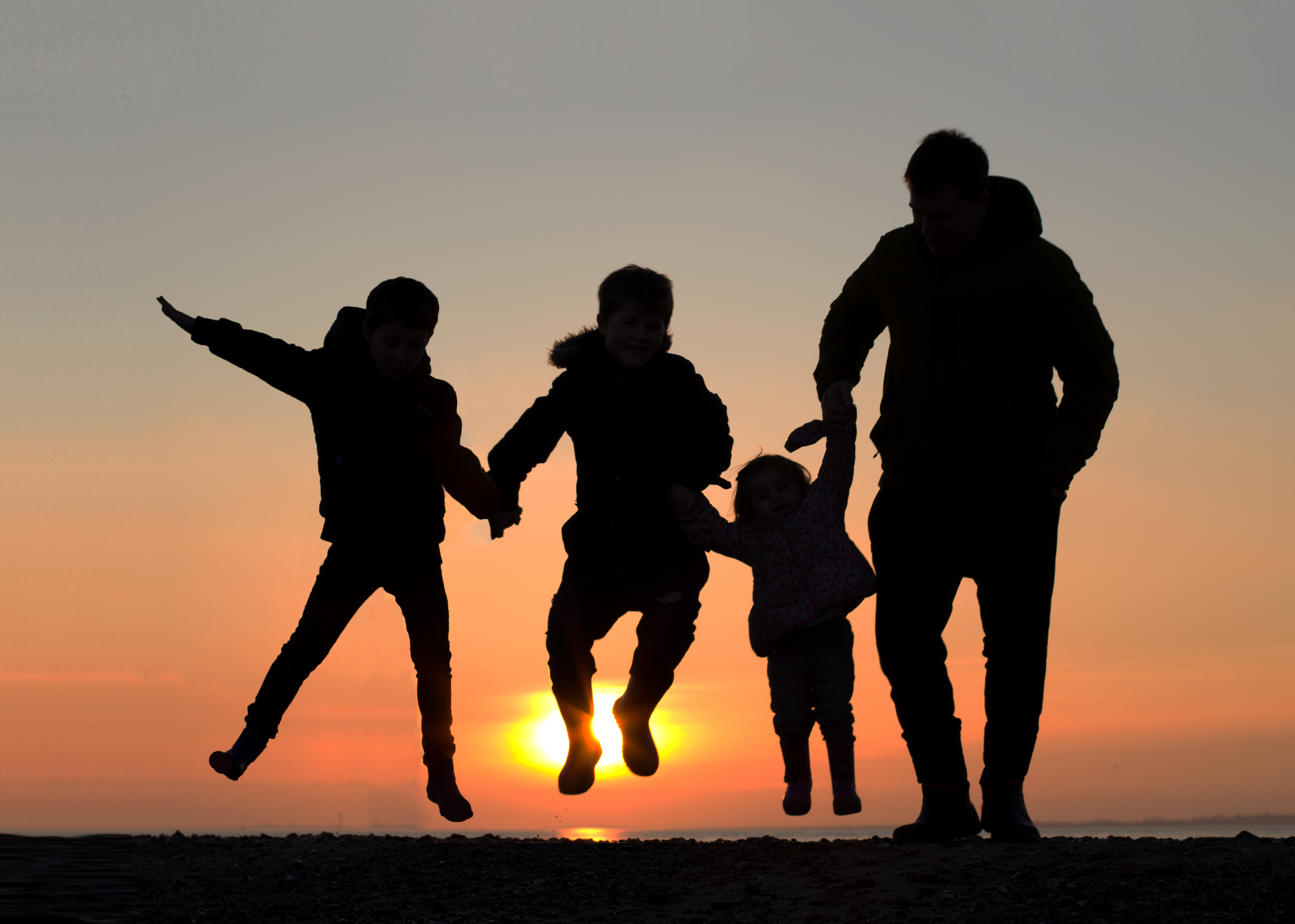 family sunset silouhette