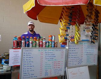 Photo of owner's brother at hotdog cart at Home Depot