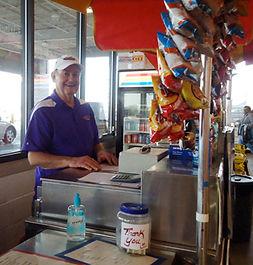 Photo of owner's dad at hotdog cart at Home Depot