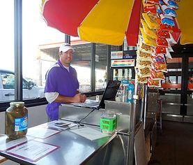 Photo of owner at hotdog cart at Home Depot