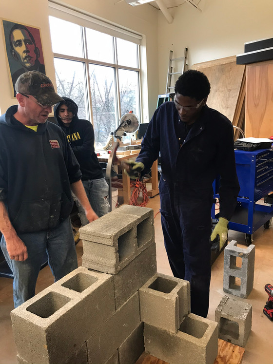 Youthbuild Students and Mentors build a wall!
