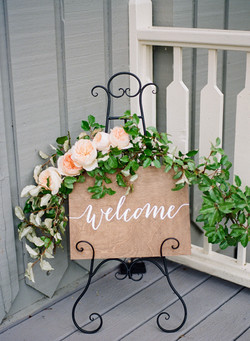 Welcome sign with garland
