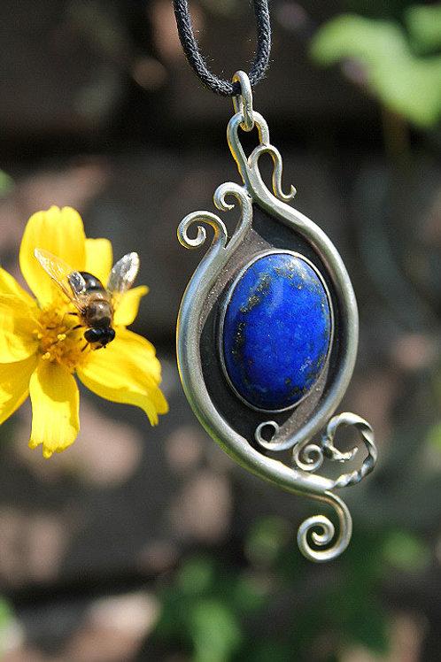 lapis lazuli pendant with scroll work