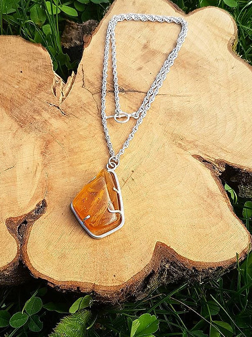 Amber pendant (with inclusions)