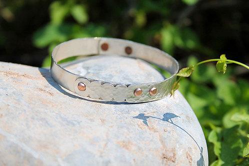 copper rivet and silver bracelet