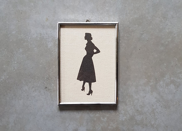 תמונת וינטג' עם איור של צללית אשה
