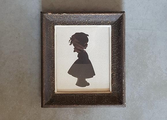 תמונת וינטג' של צללית ילדה