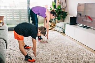 Mother and son exercising with a virtual