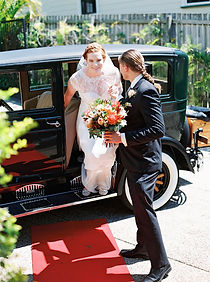 Bride arriving in vintage car Roaring Twenties Vintage Car Hire