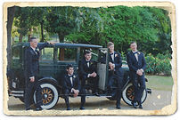 Groom possing with vintage car Roaring Twenties Vintage Car Hire