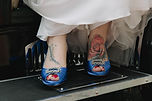 Brides tattoed blue shoes on vintage car running board  Roaring Twenties Vintage Car Hire