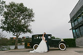 newly wed couple with vintage car  Roaring Twenties Vintage Car Hire