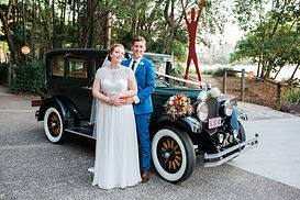 Newly wed couple in front of vintage car Bonnie Roaring Twenties Vintage Car Hire