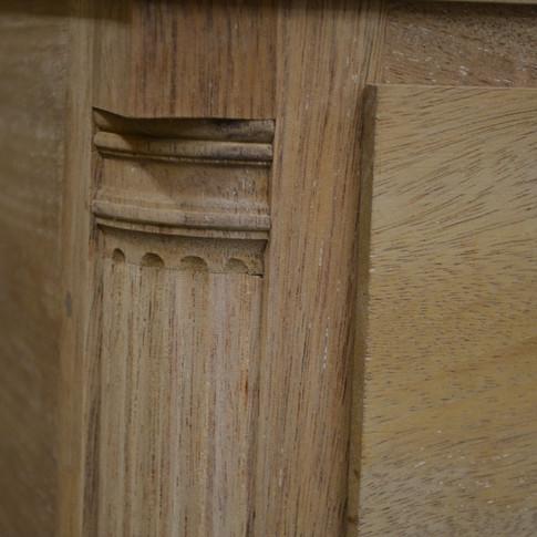 detail of unfinished quarter column and plinth block