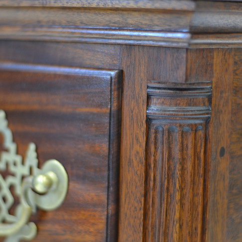 detail of quarter column and lipped drawer