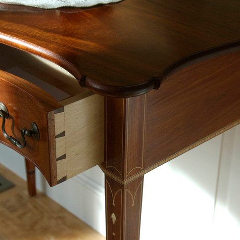 detail of dovetails and cockbead