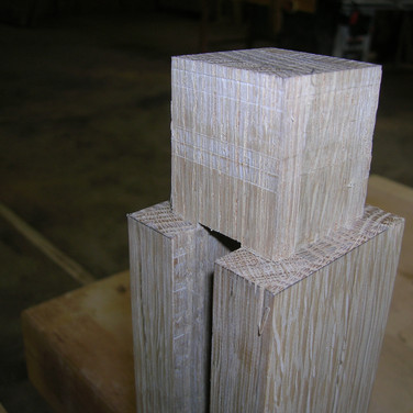 through tenon joining leg to arm
