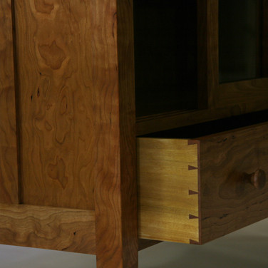 detail of handcut dovetails and turned knobs