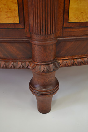 detail-of-foot-and-carved-and-veneered-skirt