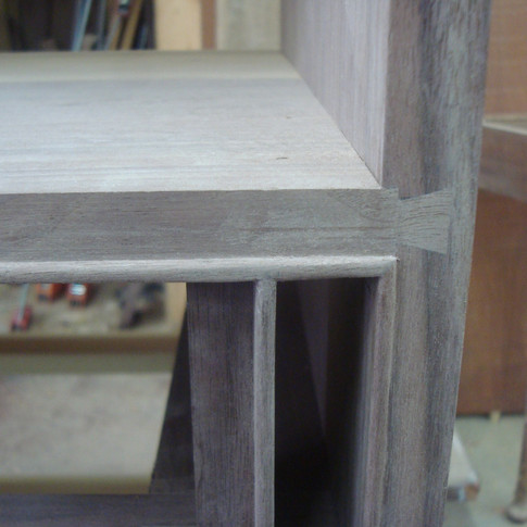 detail of cockbead and handcut dovetails joining writing surface to case
