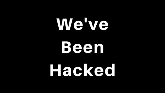 """Words 'We've Been Hacked"""" in white on black background"""
