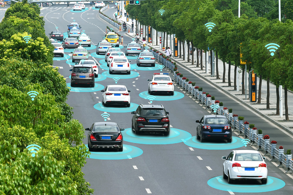 Cars driving on a busy road with graphics overlaid to display wireless connectivity to each other