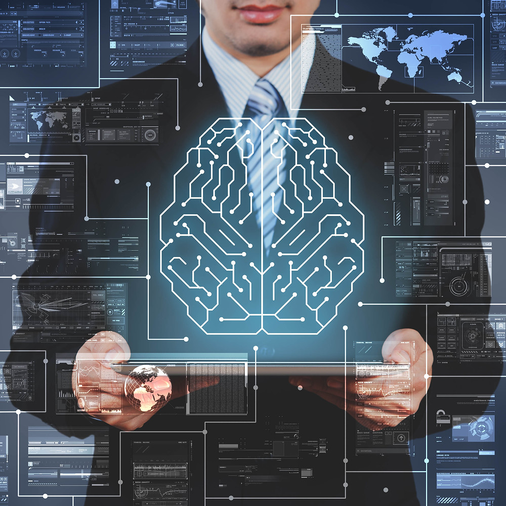 Man holding futuristic tablet displaying overlays of data and circuits combing to form a brain