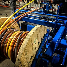 Machine cutting a large cable