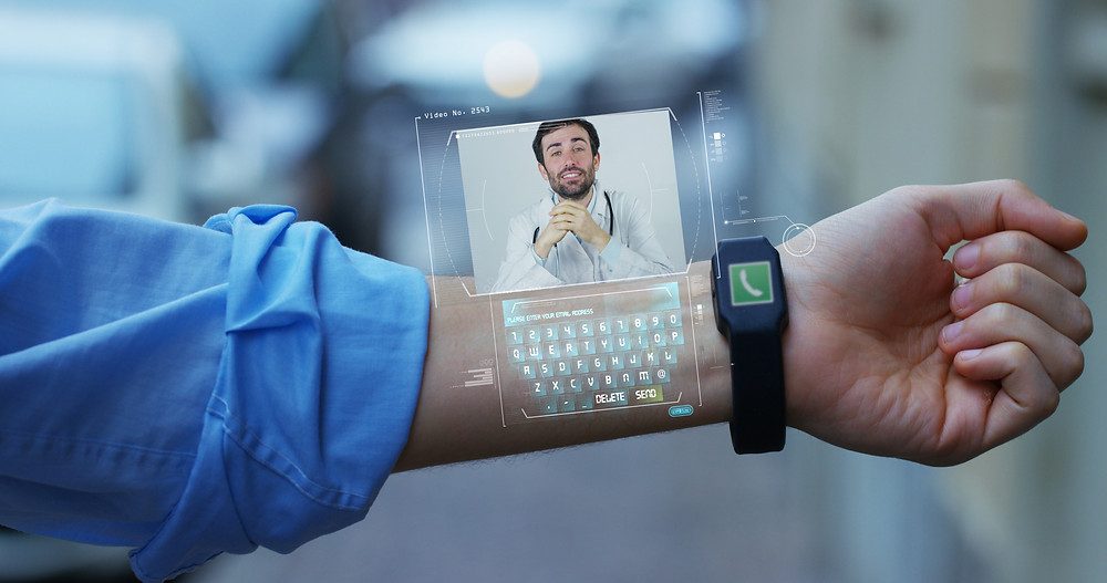 Photo of a smartwatch beaming hologram of a video conference with doctor on a person's inner arm.