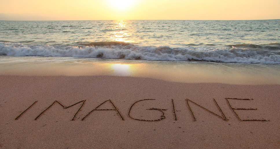 Imagine%20written%20in%20the%20sand%20on