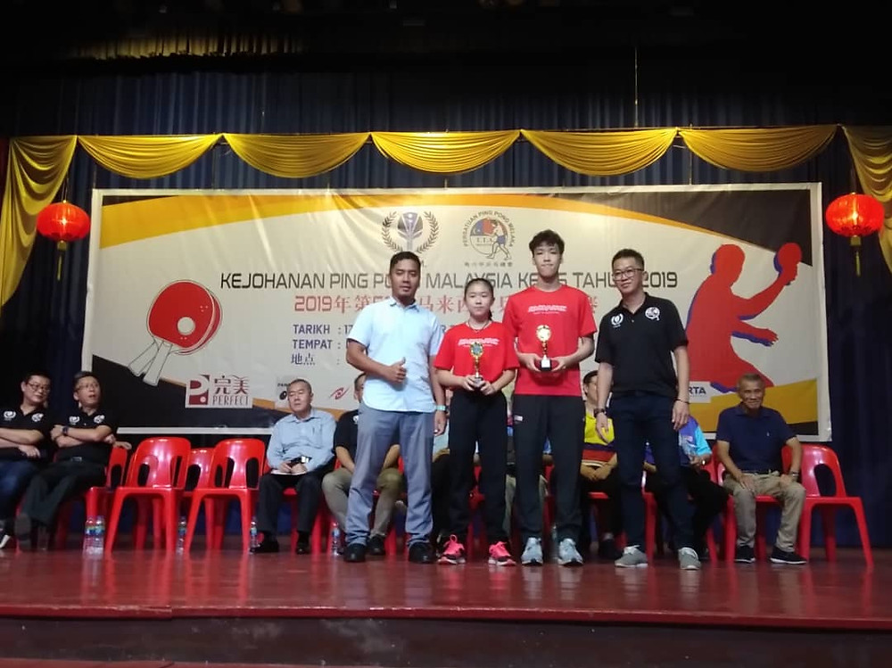 Xin Ni (left) and Javen (right) obtaining bronze in the mixed doubles.s