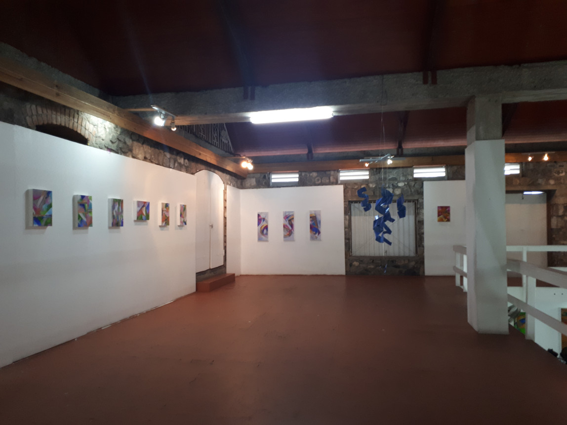 Paintings and mobiles in the Mezzanine of the Old Mill gallery