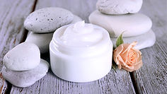 Container of face cream used for facial spa services