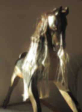 carved wooden horse on gliding stand