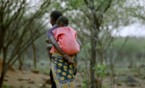 Kenyan mother carrying child. Lillian Lincoln Foundation.