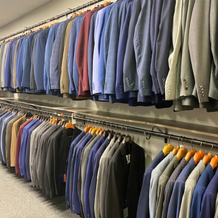 Wall of Suits - Gurcan Tailor Newark, NY