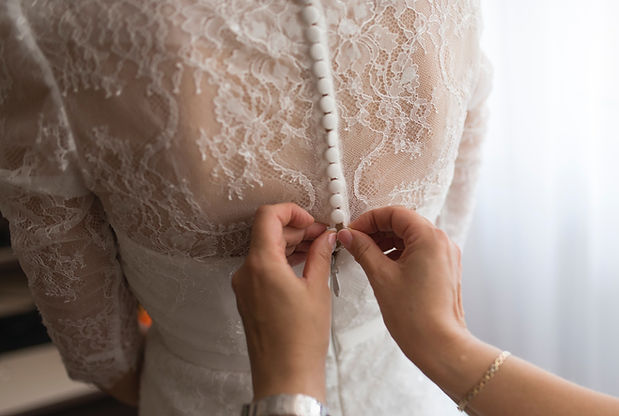 image shows a wedding dress at Gurcan Tailor being altered. wedding gown alterations are our speaclisty.