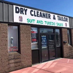 Outside signage of Gurcan Tailor in Newark, NY