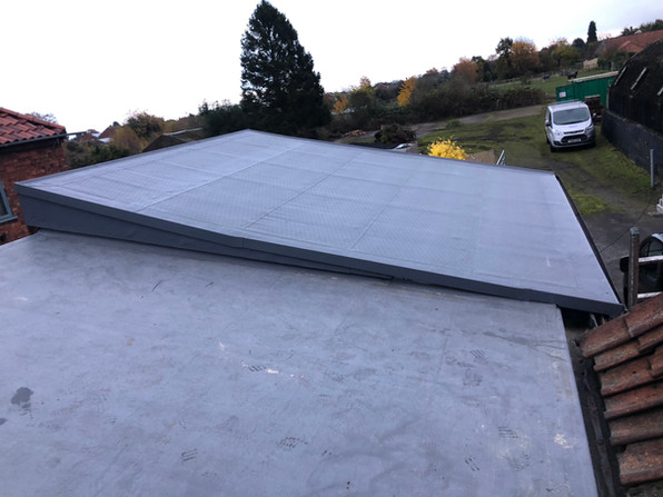 Flat roof with 15 degree pitch on a out-house